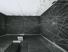 Sol LeWitt, Wall Drawing #289: A six-inch (15cm) grid covering each of the four black walls. White lines to points on the grid. 1st wall: 24...