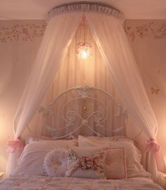 Just love the pink canopy and all of the throw pillows!