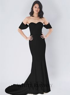 Amira Detachable Sleeve Gown. An elegant floor length gown by Samantha Rose. A strapless style featuring detachable sleeves and floor sweeping train.