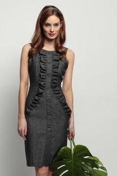 Jude, in a gray wool ruffled work dress.  I see this with a black blazer and some silver jewelry...
