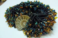 bracelet by Diane Briegleb....done on loom using seed beads and amber