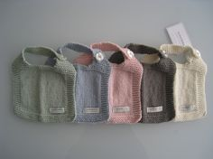 I just love these bibs - use a washcloth or hand towel pattern - square with an extended arm to button.