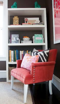 Beautifully styled reading corner by Julie from Shelter Interior Design.  Note the Domino book leaning against a stack of magazines.  Wouldn't that be a great way to display one's back issues?  I also like the combo of Manuel Canovas toile and zebra stripes on a solid chair.
