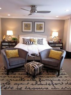 Master bedroom. Love the neutral with pops.of yellow