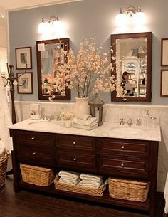 Dark wood vanity with light blue walls and white tile