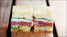 Italian pressed sandwiches made with sopressata, prosciutto, mozzarella, provolone, and fresh pesto. The best sandwich! Pressed Sandwich, Soup And Sandwich, Antipasto, Crepes, Good Food, Yummy Food, Wrap Sandwiches, Italian Sandwiches, Picnic