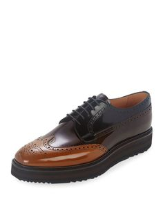 Prada derby shoe in tricolor leather with stacked sole. Perforated wing-tip motif. Lace-up front. Leather lining and insole. Lugged rubber sole. Made in Italy.