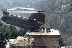 """According to the submitter, """"This photo was taken by a soldier in Afghanistan of a helicopter rescue mission. The pilot is a Pennsylvania National Guard guy who flies EMS choppers in civilian life. Now how many people on this planet do you reckon could set the ass end of a chopper down on the roof top of a shack on a steep mountain cliff and hold it there .. while soldiers load wounded men in the rear? If this does not impress you ... nothing probably ever will. Can you imagine the nerve…"""