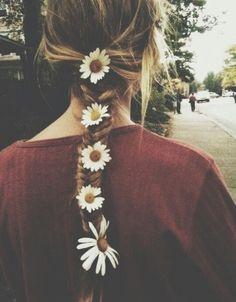 Flowers in her braid.