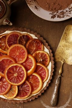 Blood Orange Tart with Mascarpone Filling and Chocolate Crust. The orange and chocolate are nice together. I have to pin this, I have a tree with hundreds of these oranges right now, need ideas!