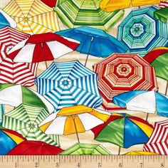 Timeless Treasures Beach Pass Umbrellas Multi from @fabricdotcom  Designed by George McCartney for Timeless Treasures, this cotton print is perfect for quilting, apparel and home decor accents. Colors include white, red, green, yellow and blue.