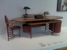 "desk from Frank Lloyd Wright's Johnson Wax Building    So not really available ""for the home"" but very cool."