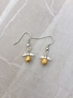 A personal favourite from my Etsy shop https://www.etsy.com/uk/listing/454516998/golden-snitch-earrings-harry-potter