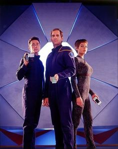 Dominic Keating (Reed), Scott Bakula (Archer), and Jolene Blalock (T'Pol) show off some of 2001's hottest tech in this PARADE Magazine photo.