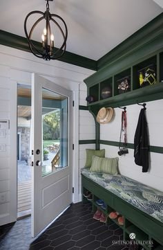 Mudroom This mudroom features shiplap, which was installed with a nickel gap. To add some contrast, the builder painted the mudroom cubbies and trim a in a deep green. Paint color is Glidden's Royal Hunter Green Mudroom Cubbies, Mudroom Bench Plans, Built In Bench, Custom Cabinetry, Built Ins, Old Houses, Architecture, Beach House, House Plans
