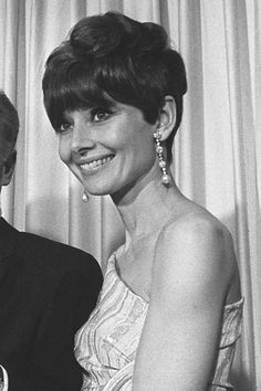 April 10, 1967, Los Angeles, California: Audrey at the 39th Academy Awards. Standing beside her, but unseen in these photos, is director Fred Zinneman (he took home two Oscars that night), who directed Audrey in The Nun's Story, and actress Rosalind Russell. Photos by David Sutton.
