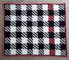 Statement pieces don't necessarily need to be large in size to have a big impact. The Modern Houndstooth Patchwork Blanket is the perfect example. Between the checkerboard looking combination of solid black and white and houndstooth squares, to the splash of color along the border, this one-of-a-kind crochet blanket pattern is definitely a statement piece.
