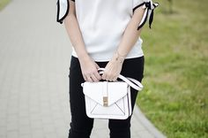 black and white outfit white bag