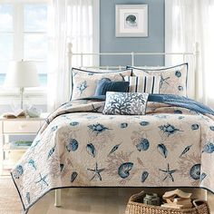 Refresh your master suite or guest room with this charming cotton coverlet set, showcasing a whimsical coastal motif.  Product:  1 Co...
