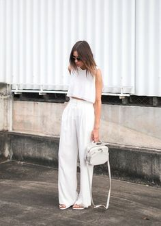 Summer whites outfit; wide leg tailored high waisted trousers with a matching white crop top.