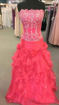 This dress is a drop waist bodice with lace and beadwork. There is a thick band around the hips with floral design just below. The skirt is ruffled creating drama on the bottom. This dress has a beaut