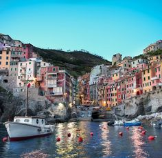 ...Riomaggiore, Cinque Terre, Italy...cinque terre means five lands...a series of five cities along a mountain ridge...you can walk along the edges of the ridge from town to town...saw it on Rick Steves...