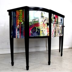 The top and legs have been painted in black eggshell paint and waxed for protection. The front has been decoupaged with stunning paper featuring a colourful graffiti city paper. The handles are original and have been given a lick of black paint. The paper has been given layers of hard-wearing gloss varnish for protection.