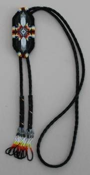 Beaded Feather Bolo Tie Why wear a tie when you can wear a Bolo Tie and be comfortable. Bolo Ties add that special touch that can dress up the casual look or add that extra touch to a business suit. This beautiful feather design was loomed with size 15 beads, has leather backing and is on leather bolo cord. The tips of the cord are beaded to give it that perfect look. Available in black, blue turquoise, and white.