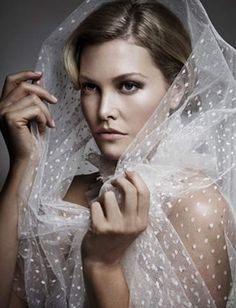 Wrap head and face with pretty material for contemporary beauty portrait