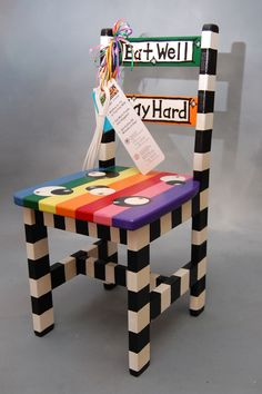 """Eat Well. Play Hard"" auctioned at the E. John Gavras Center Imagination Library Celebration Silent Chair Auction"
