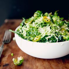 This flavorful salad showcases the contrasting textures of raw and crisp, fried kale and brussels sprouts in a tangy Southeast Asian dressing.