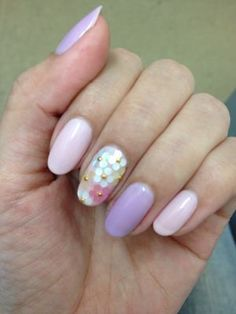 Rounded summer style nails with flower nail art