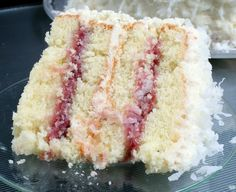coconut cake with raspberry filling omg! Literally my future wedding cake!