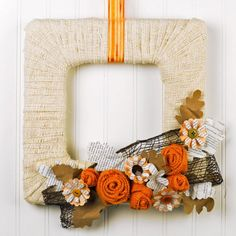 Fall's favorites in one wreath: burlap; orange, burlap roses; book page flowers & leaves; and mesh ribbon. And cool -- it's square!