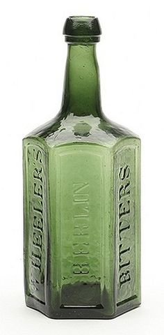 Wheeler's Berlin Bitters Baltimore glass bitters bottle in yellowish grass green with indented panels