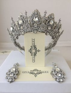Created from delicate metal filigree and pure shining rhinestones. A gorgeous crown will adorn any girl as a queen, and elongated drop earrings will give out graceful facial features. Wedding Headband, Silver Wedding Crowns, Gold Wedding Crowns, Silver Tiara, Bridal Tiara, Crystal Wedding, Bridal Jewelry, Women's Jewelry, Wedding Tiaras
