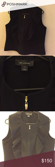 St John's vest This festive black vest has a zippered front and a tapered ruffle down the front of each side. Photo 3 and 4 were lightened to show the details of this piece but it is a dark black color. Size 10. Fabric content is 3% cashmere, 55% angora, 32% wool and 10% nylon. EUC. St. John Jackets & Coats Vests