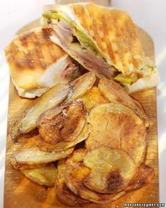 Cuban Sandwiches  Citrus-marinated roast pork loin, ham, Swiss cheese, and dill pickles fill these grilled sandwiches. Serve them with spicy mustard and plantain chips on the side.