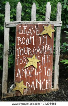 "sign saying ""leave room in your garden for the angels to dance"" by Joy Brown, via ShutterStock"