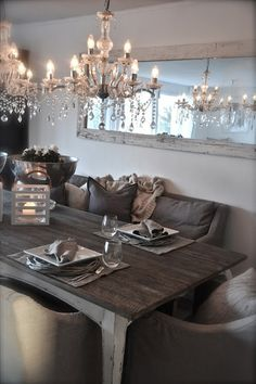 Eating/dining area with cozy seating, rustic wood harvest table and chandelier