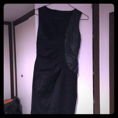 Black dress with leather cut out Midi black dress with midi cut out. Form fitting available in size medium only. Dresses Midi