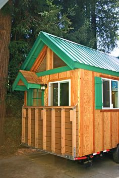Fold up deck... Allows for full use of trailer bed for home and still have a porch!