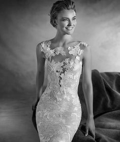 Pronovias > NIEBLA - Tulle and Chantilly wedding dress with a bateau neckline and embroideries