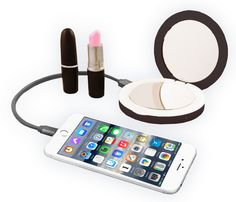 BLACK  The Beauty Bank by S. Taylor London features an illuminated compact mirror and convenient USB battery power bank for iPhone, iPad, Android & all your beauty needs.  Textured with a velvety feel, and an ensured closure with magnetic snap.