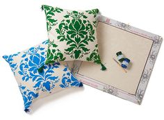 Stencil your own colorful throw pillow with a kit you can customize. We like the Wild Berry Damask DIY pillow stencil kit with pillow, cover, stencil, paint, mini roller, and brush. Just $45 (a fraction of the cost of designer pillows!) from cuttingedgestencils.com