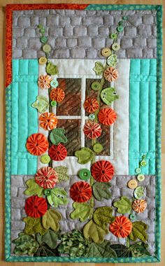Hollyhocks (PatchworkPottery) I made this Hollyhock quilt for a mini quilt swap. My partner liked yo-yos and the colour orange so hollyhocks immediately popped to mind! I started off making the yo-yos because I just love makingCute use of yoyosHollyh Applique Wall Hanging, Quilted Wall Hangings, Wall Hanging Quilts, Patchwork Quilting, Applique Quilts, Hexagon Patchwork, Crazy Quilting, Hand Quilting, Machine Quilting
