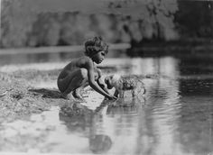 Frank Hurley - Aboriginal Boy and Puppy. Australia 1914 AD
