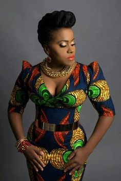 Etana looks like a real African Queen in this print. It compliments her skin tone perfectly. Vibrant colors for a talented Artist like Etana. This pic speaks volume. African Inspired Fashion, African Print Fashion, Africa Fashion, Fashion Prints, Ethnic Fashion, African Print Dresses, African Fashion Dresses, African Dress, Ghanaian Fashion