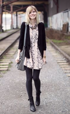 Cute dress and color scheme. I love black tights with black boots.