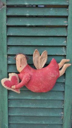Primitive Folkart Angel Doll Holding heart